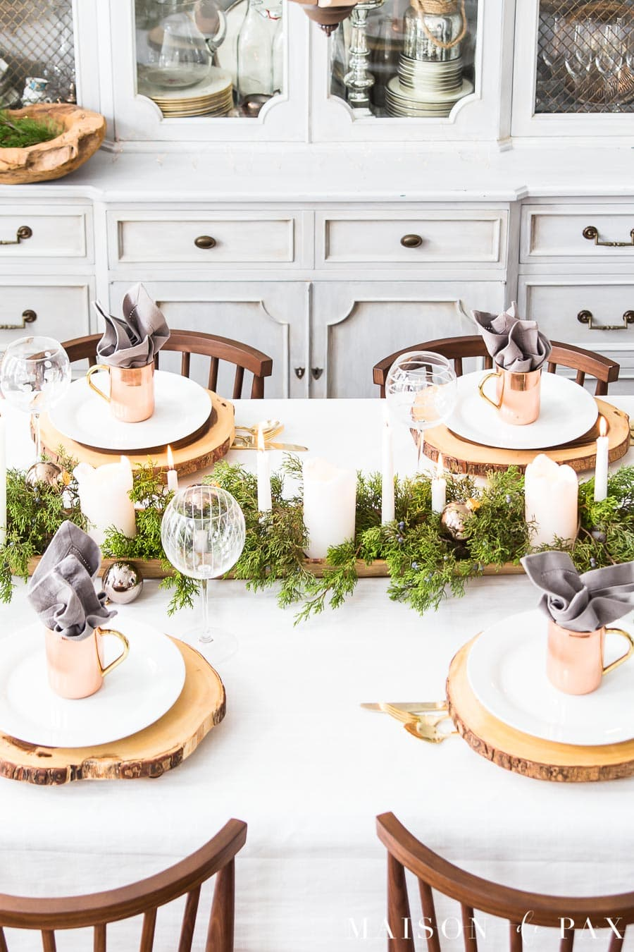 this is a white christmas inspired tablescape with rose gold elements