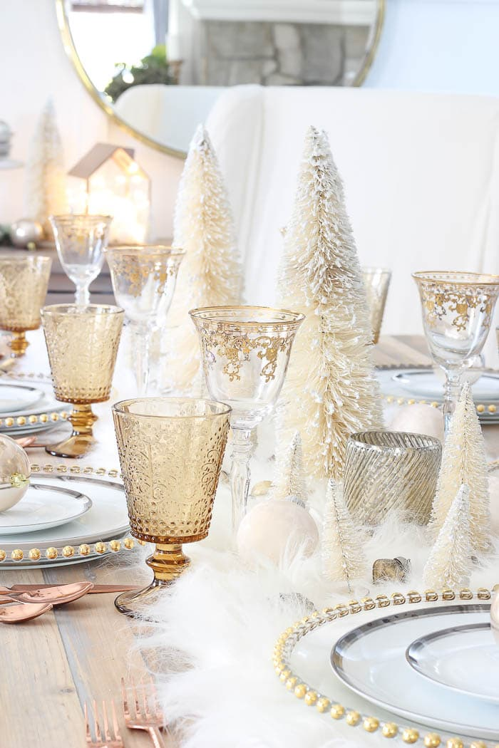 this is a winter wonderland inspired tablescape with gold elements