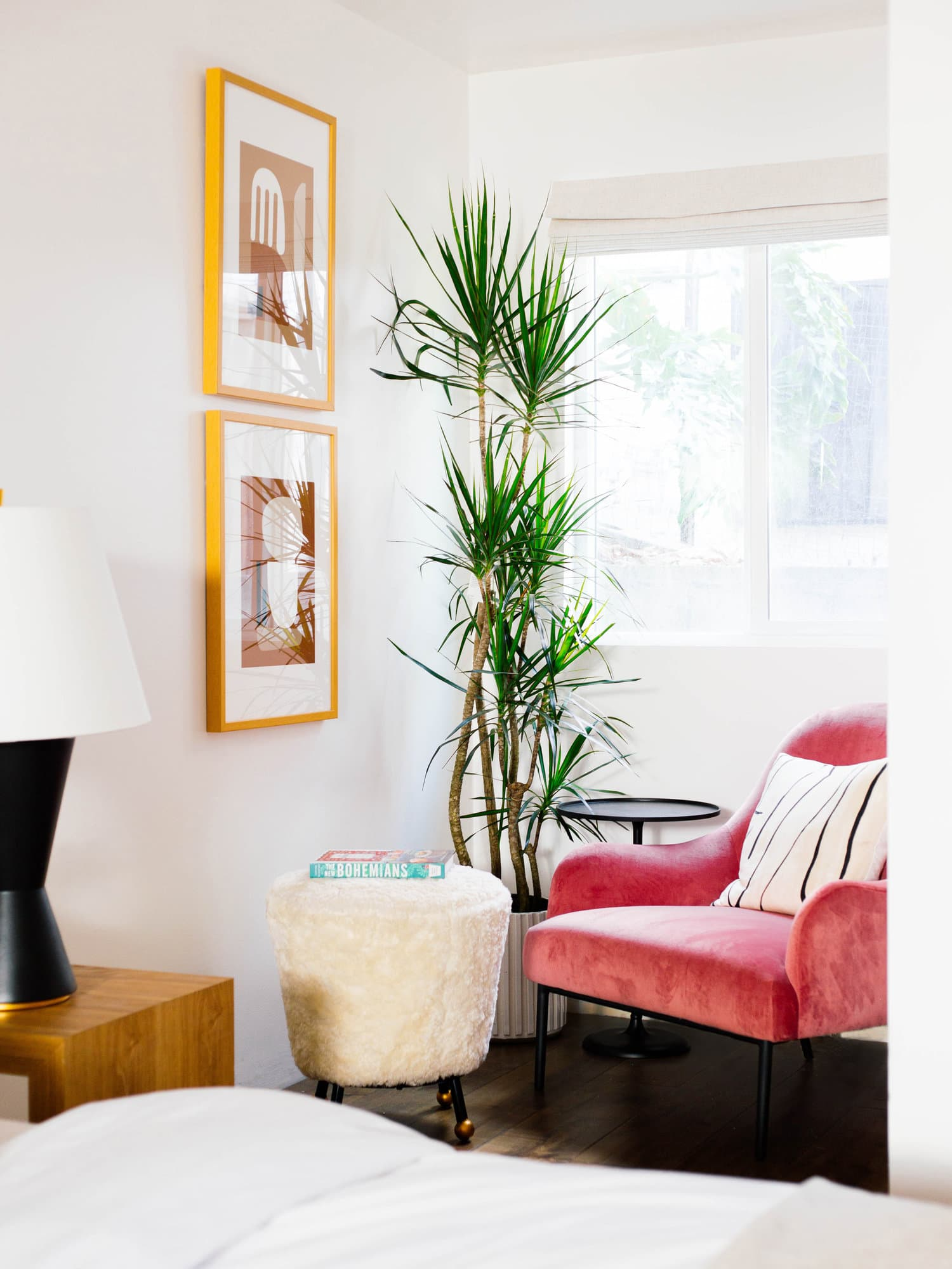 this is an eclectic sitting area in a mid century modern inspired home