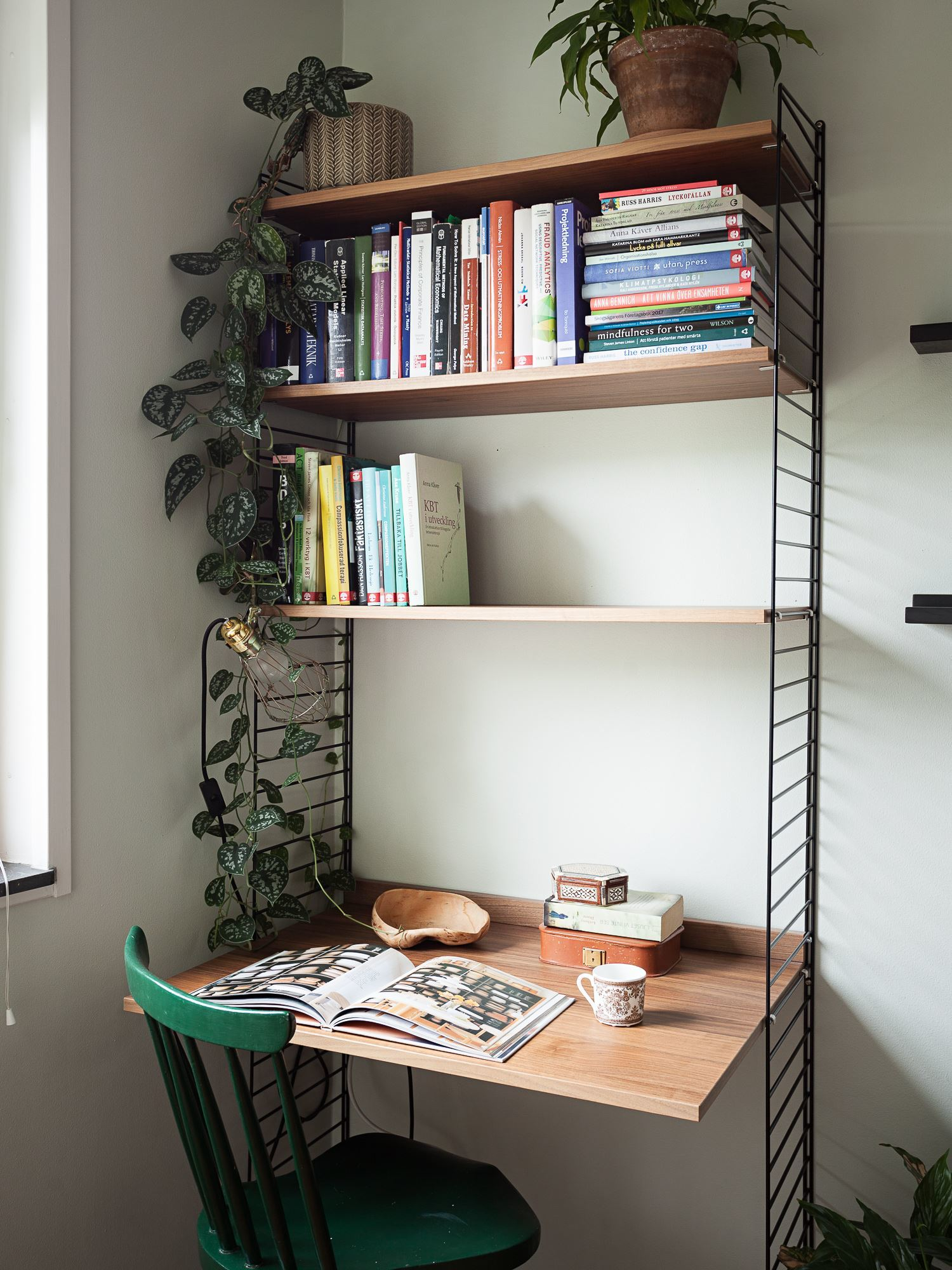 this is a multipurpose home office made with shelves and a desk