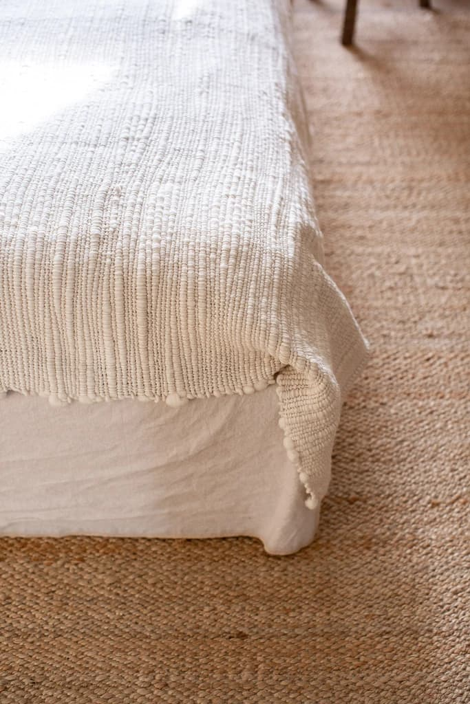 this is a bed with textured fabrics