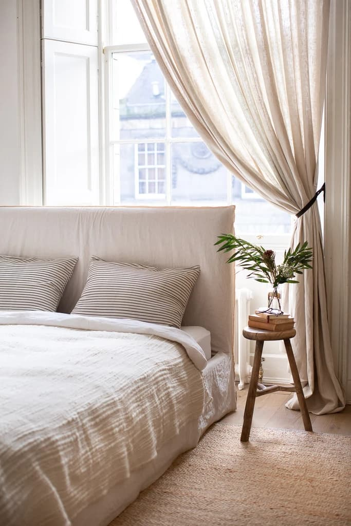 this is a calming bedroom by ingredients ldn featuring linen curtains and textiles