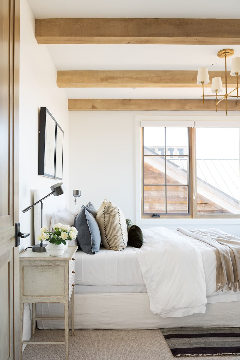 this is a calming bedroom by studio mcgee with minimal bedside decor