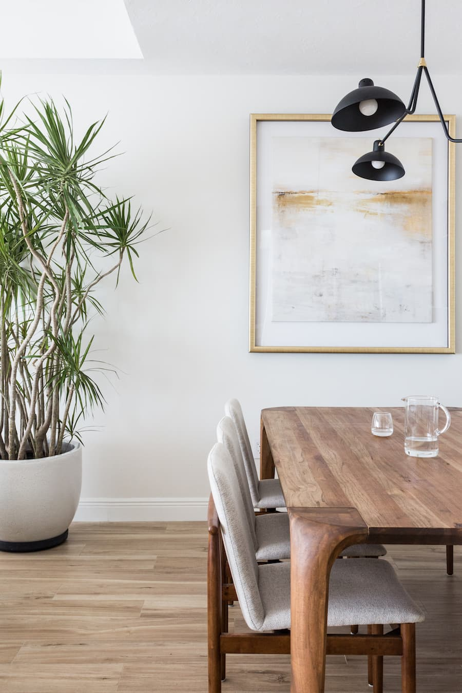 this is a japandi inspired dining room with houseplants