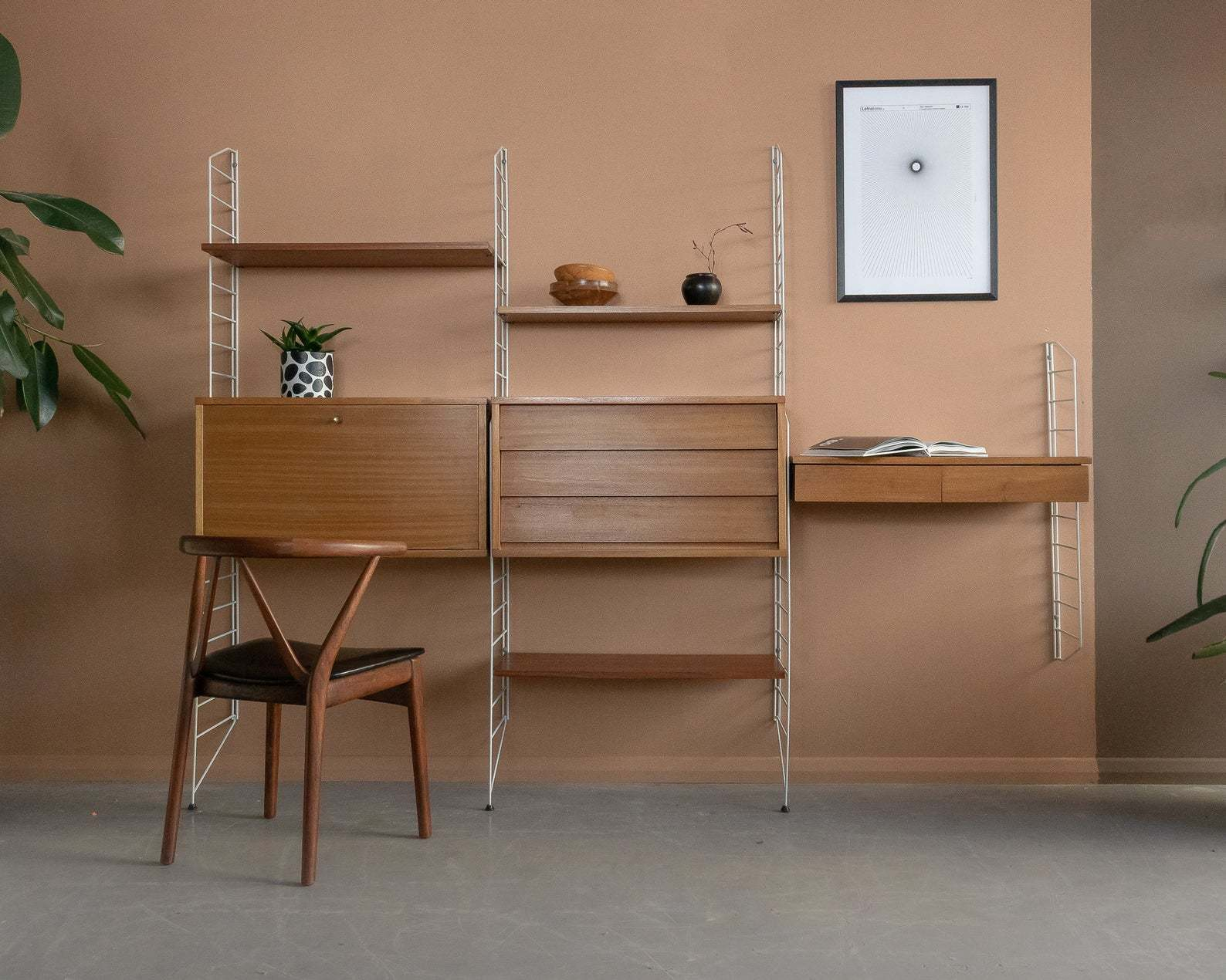 this is a mid century modern wall system by Nils Nisse