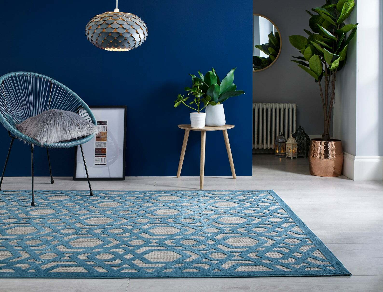 this is a piatto oro blue mid century. modern rug