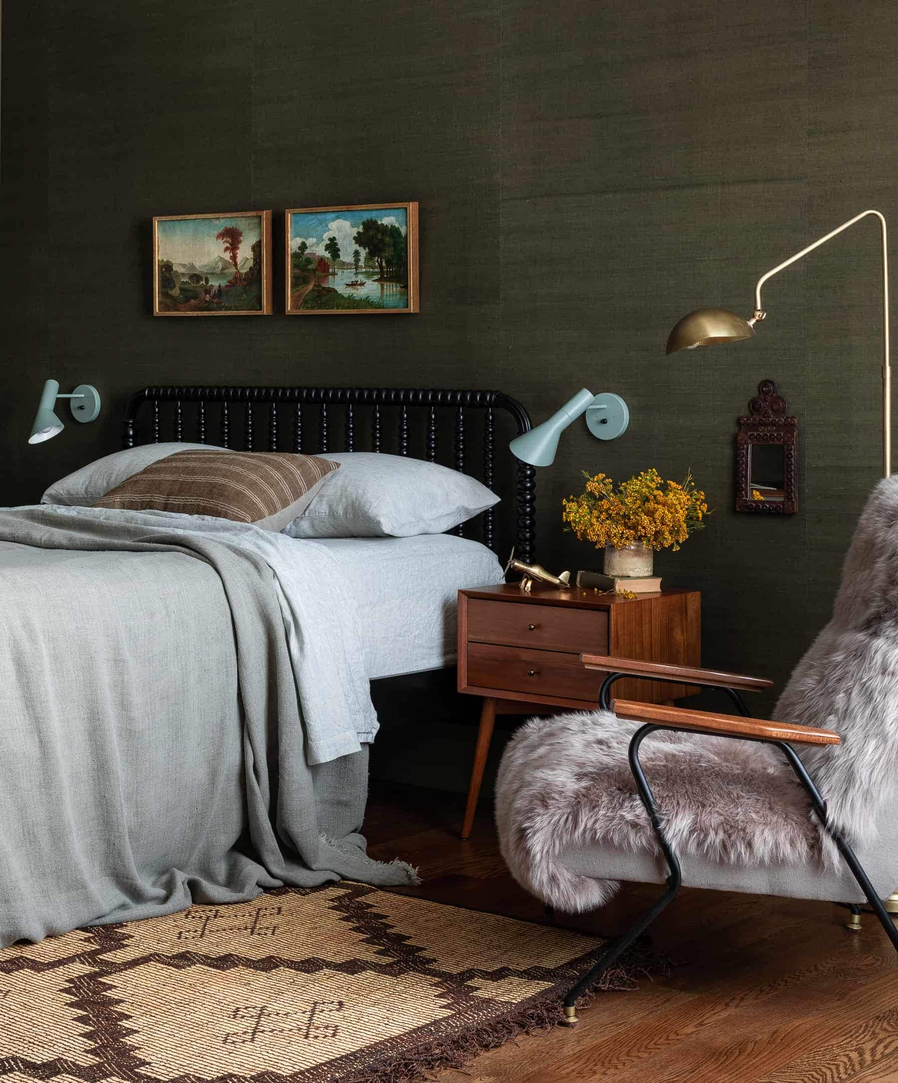 this is an eclectic dark bedroom by heidi caillier