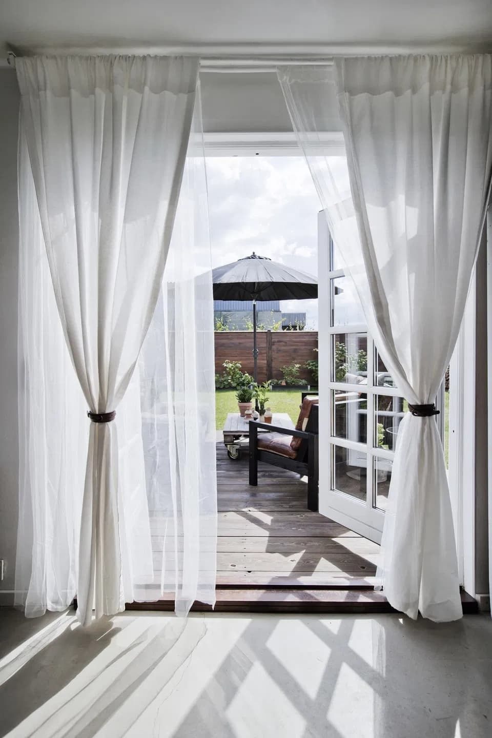 this is a back door with light curtains to a garden