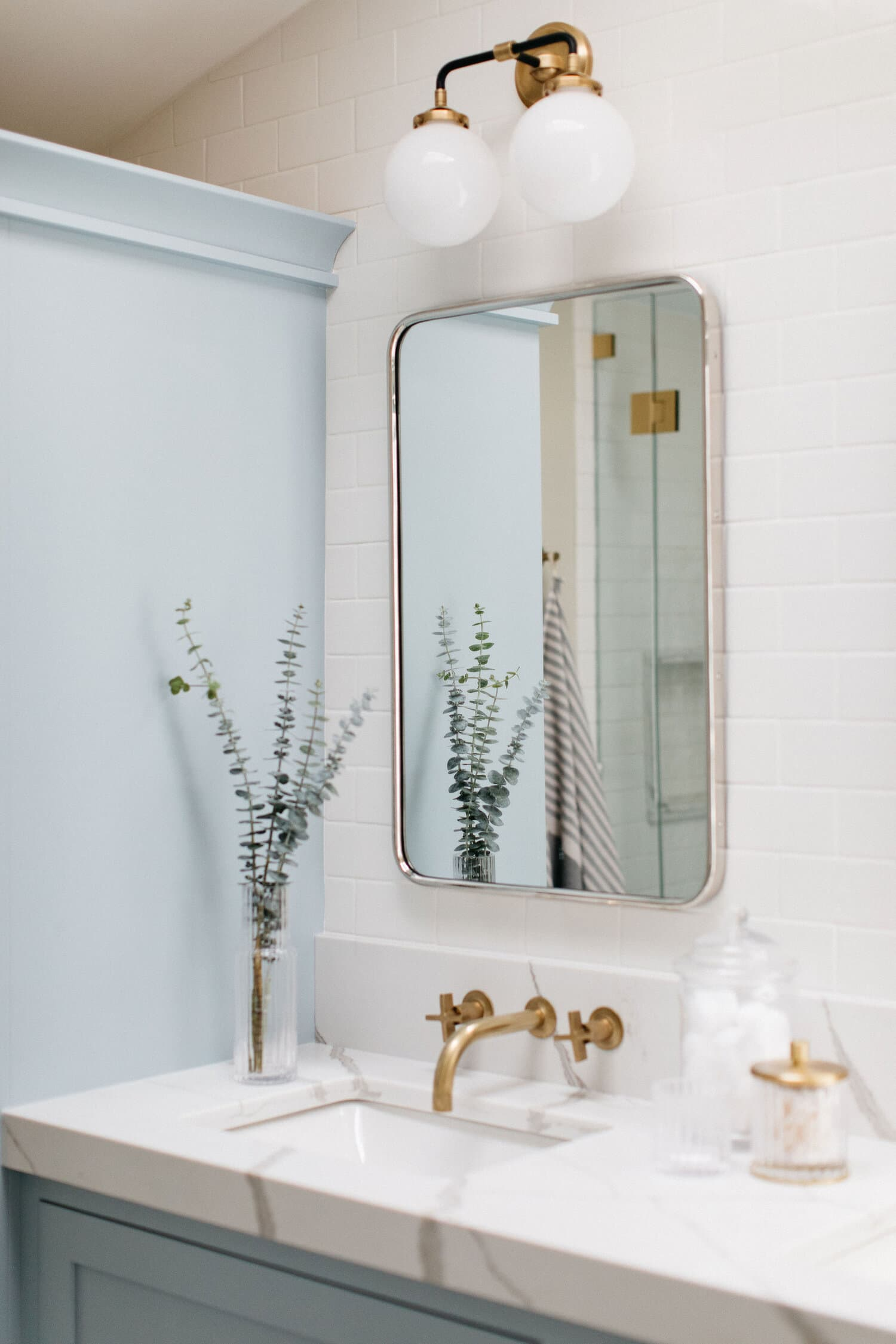 this is a bathroom with pale blue colours