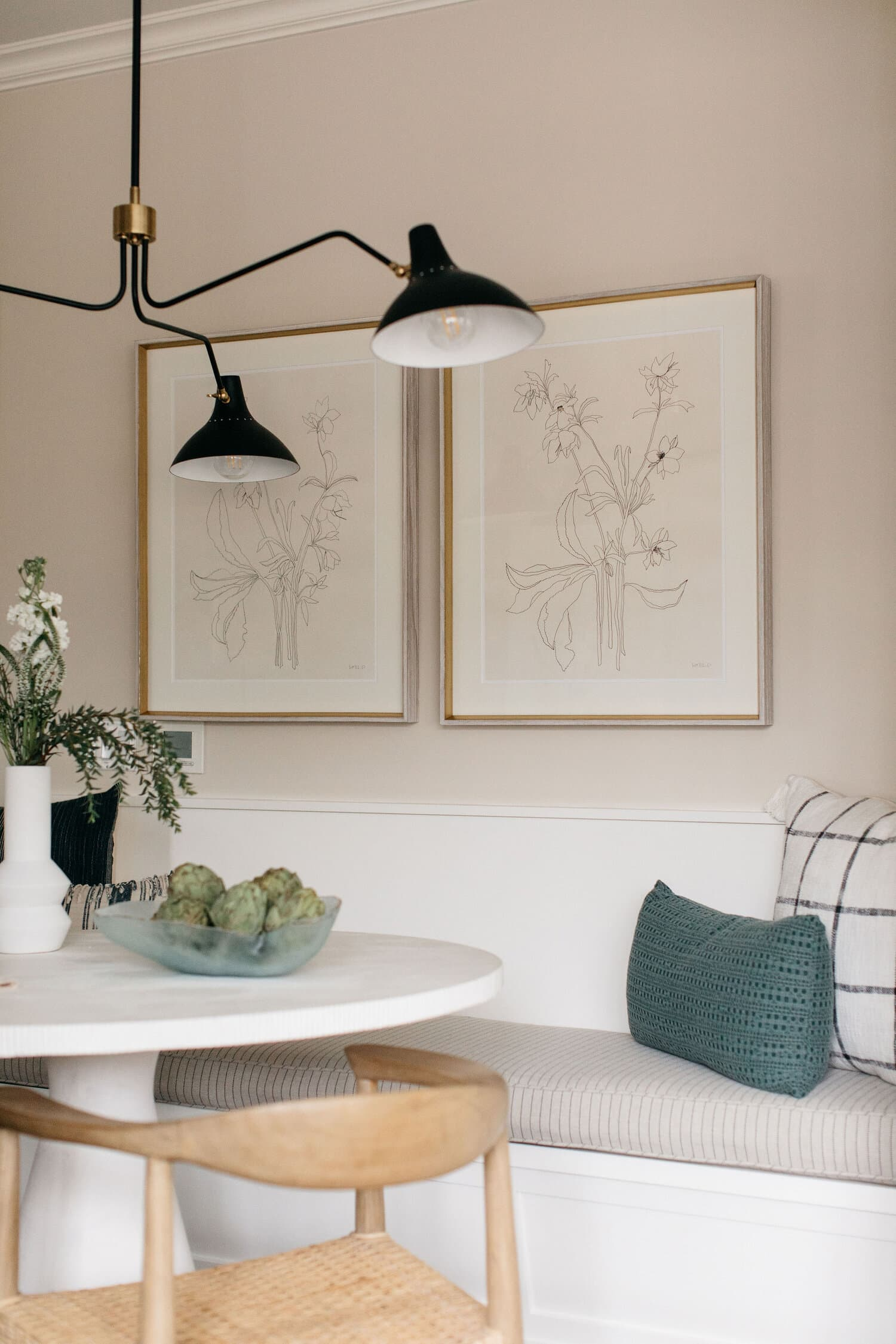 this is a breakfast nook with a pale cream shade inspired by spring 2021