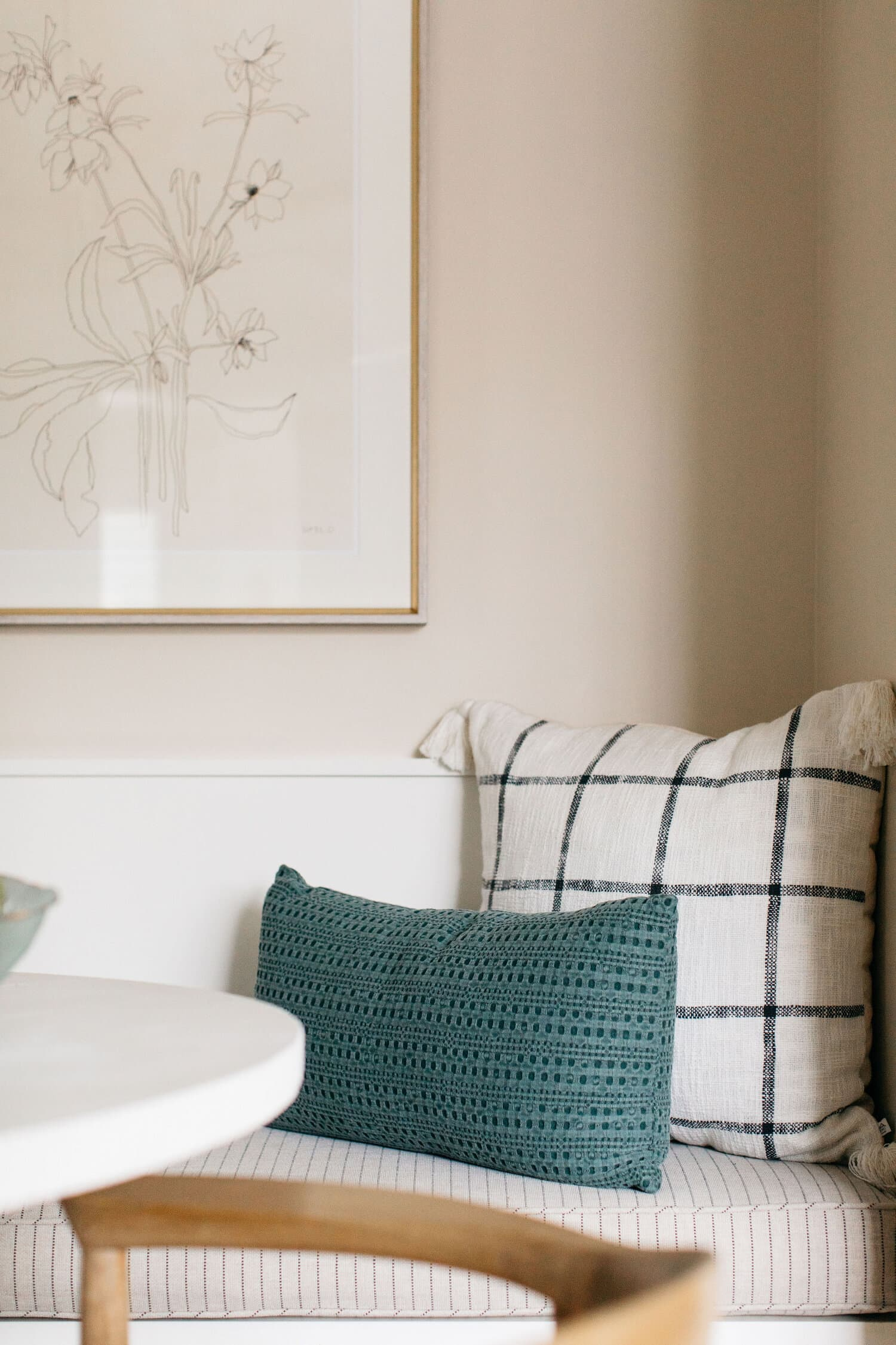 this is a breakfast nook with a pale cream shade inspired by spring