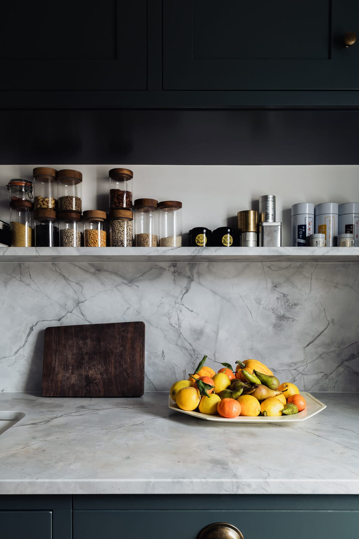 this is a close up of a dark kitchen by the modern house
