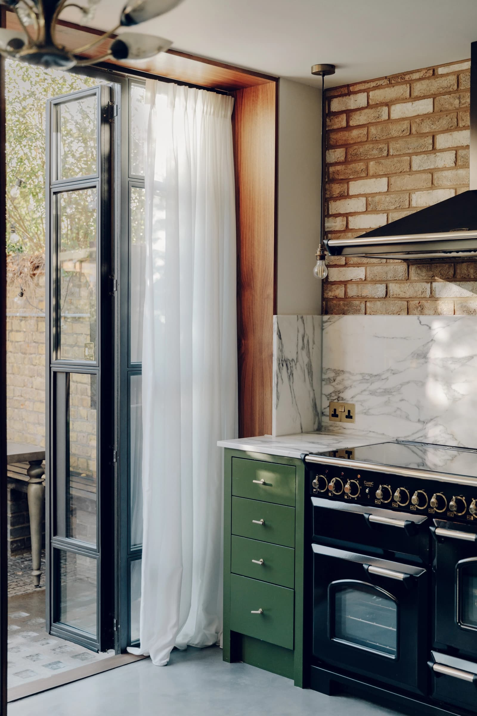 this is a contemporary and industrial kitchen with a green shade and wooden elements