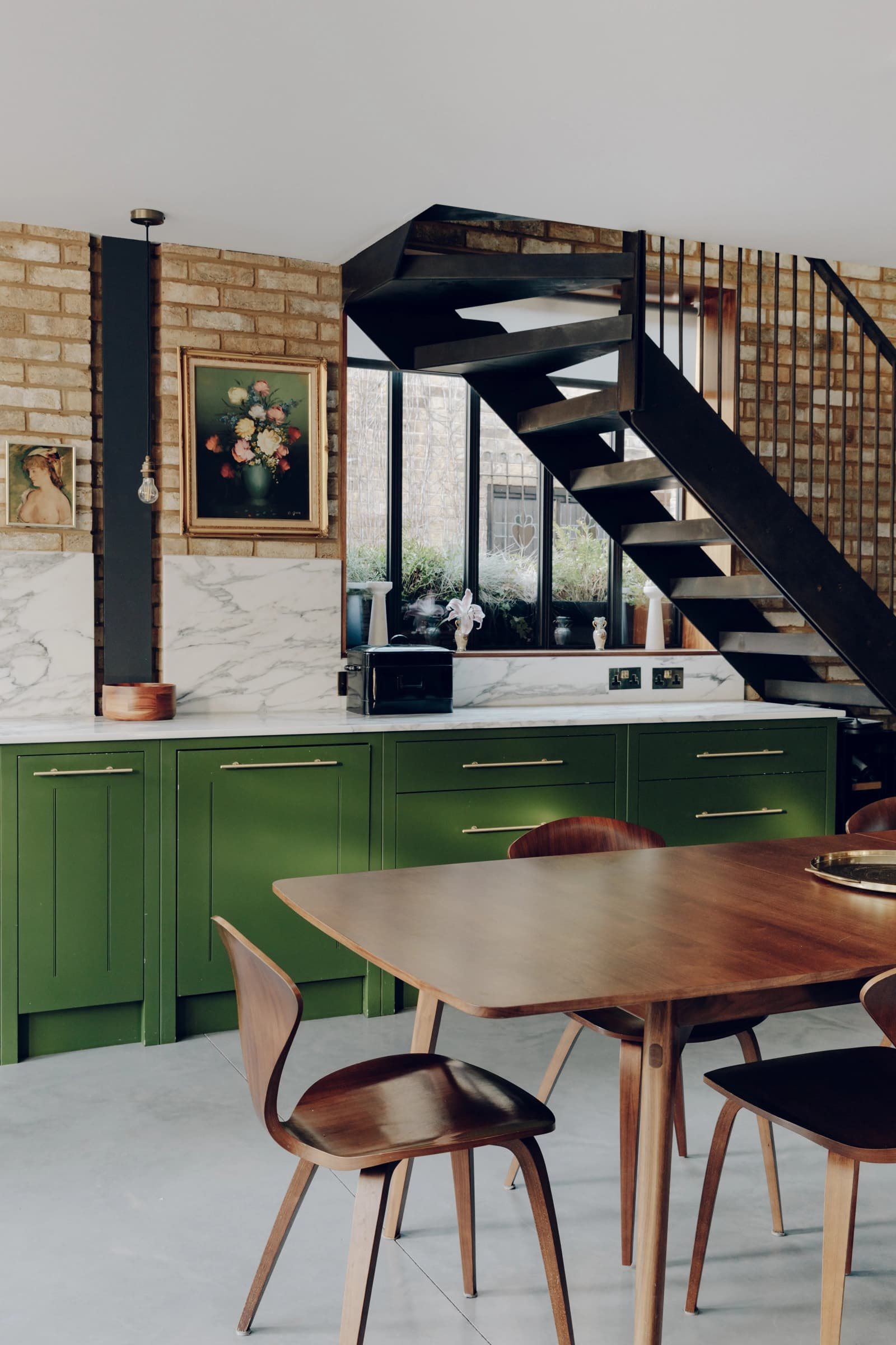 this is a contemporary and industrial kitchen with a green shade