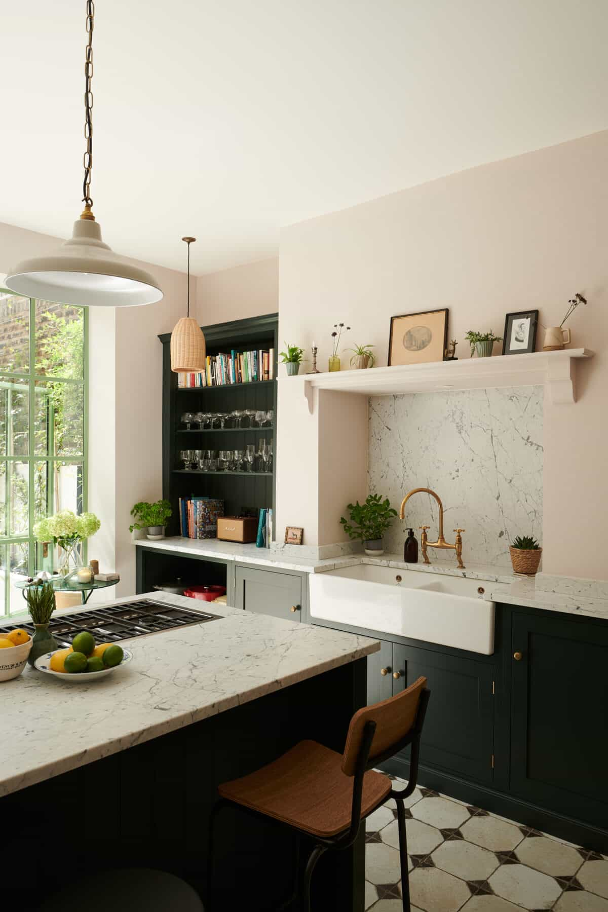 this is a devol kitchen with a large apron sink