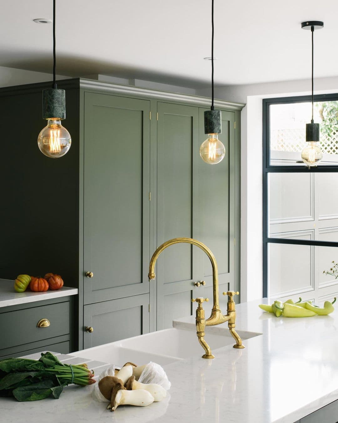 this is a deVOL kitchen with a two sink butler sink and gold taps
