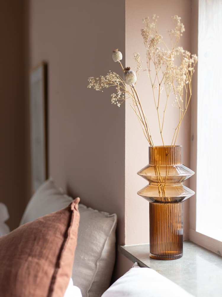 this is a nature inspired bedroom with muted rose shade perfect for spring 2021