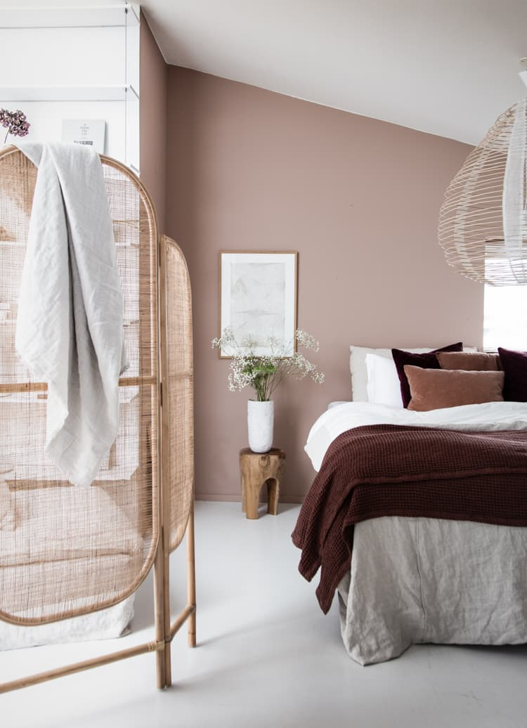 this is a nature inspired bedroom with muted rose shade
