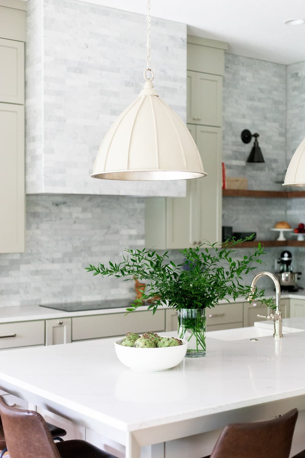 this is a spring inspired kitchen with light green cabinets