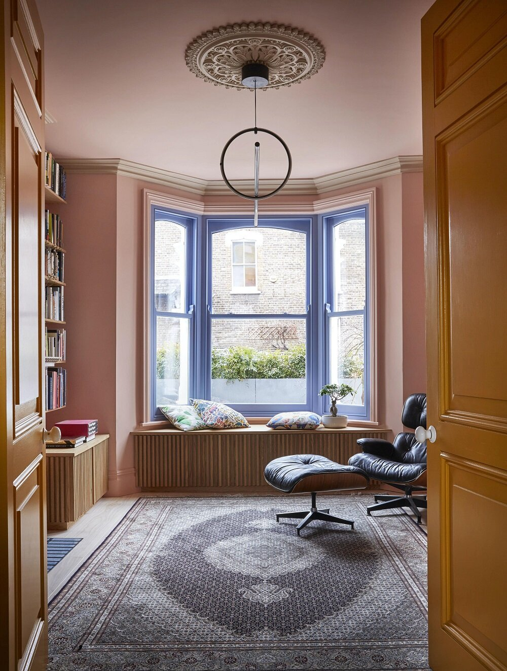 a modern home with eames lounge chair in home office