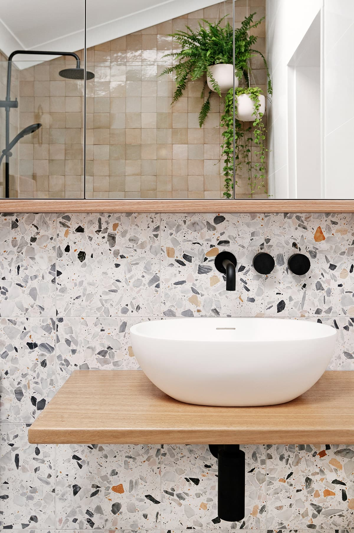 this is a bathroom with terrazzo tiles by we are scout