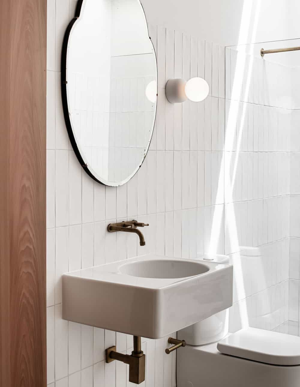 this is a bathroom with white tiles