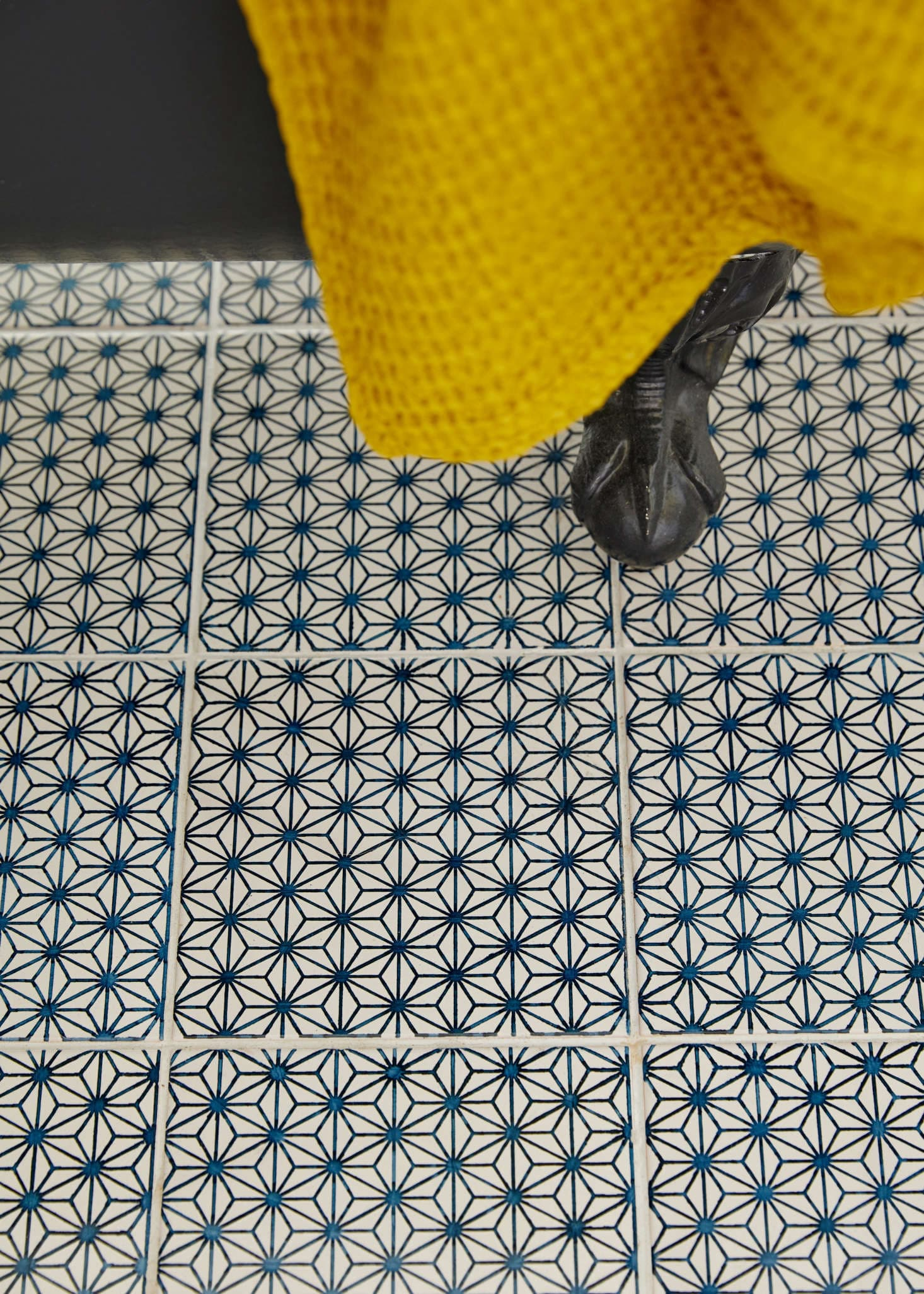 this is a close up of bathroom tiles in a eclectic bathroom