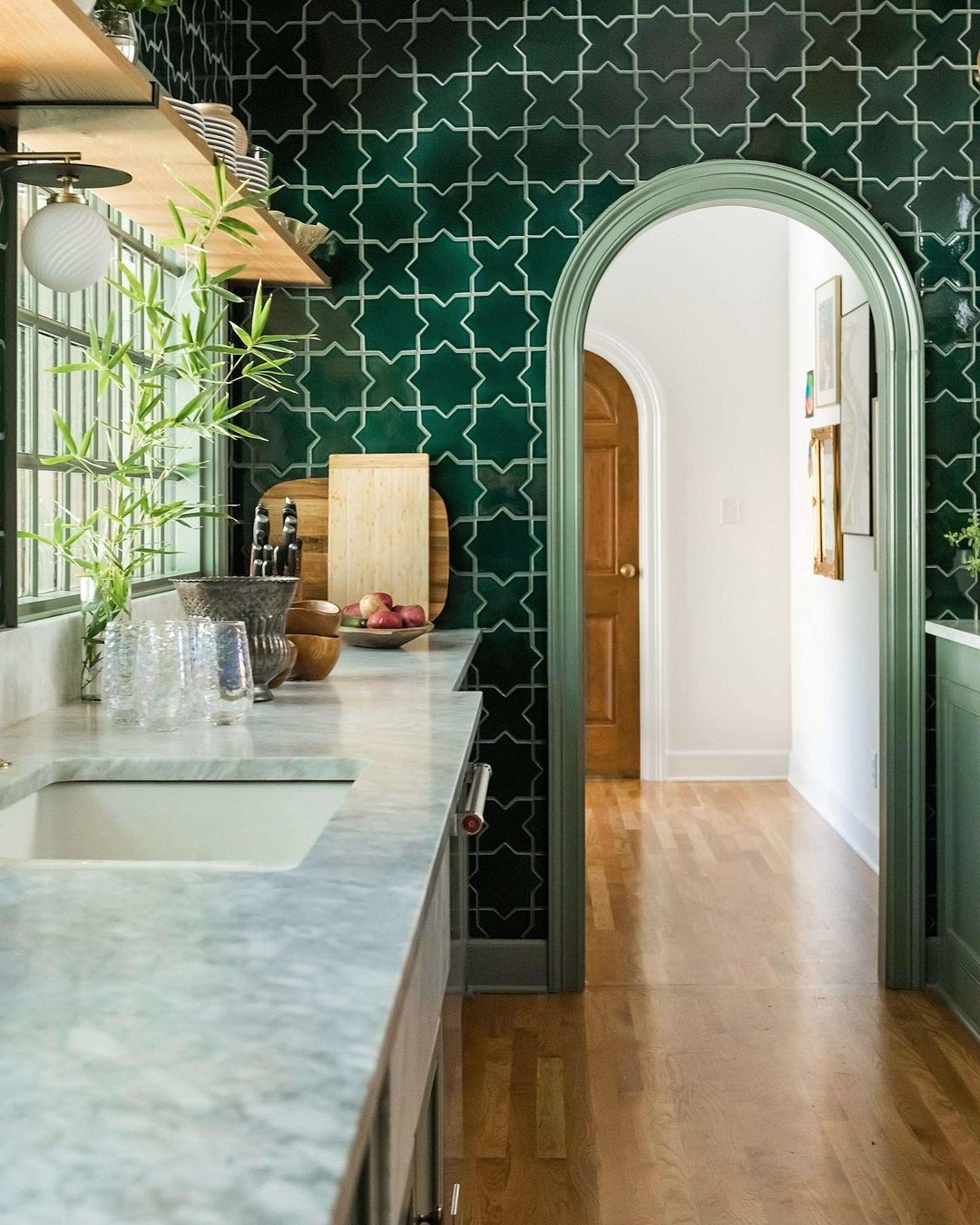 this is a kitchen with green tiles by Rebecca Gibbs