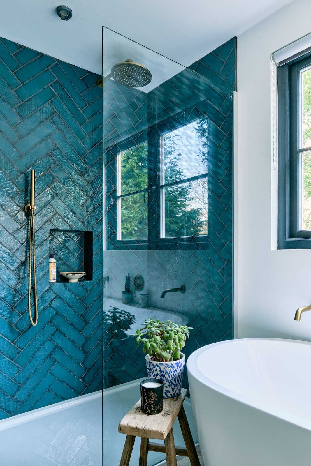 this is an eclectic shower with blue tiles by the modern house