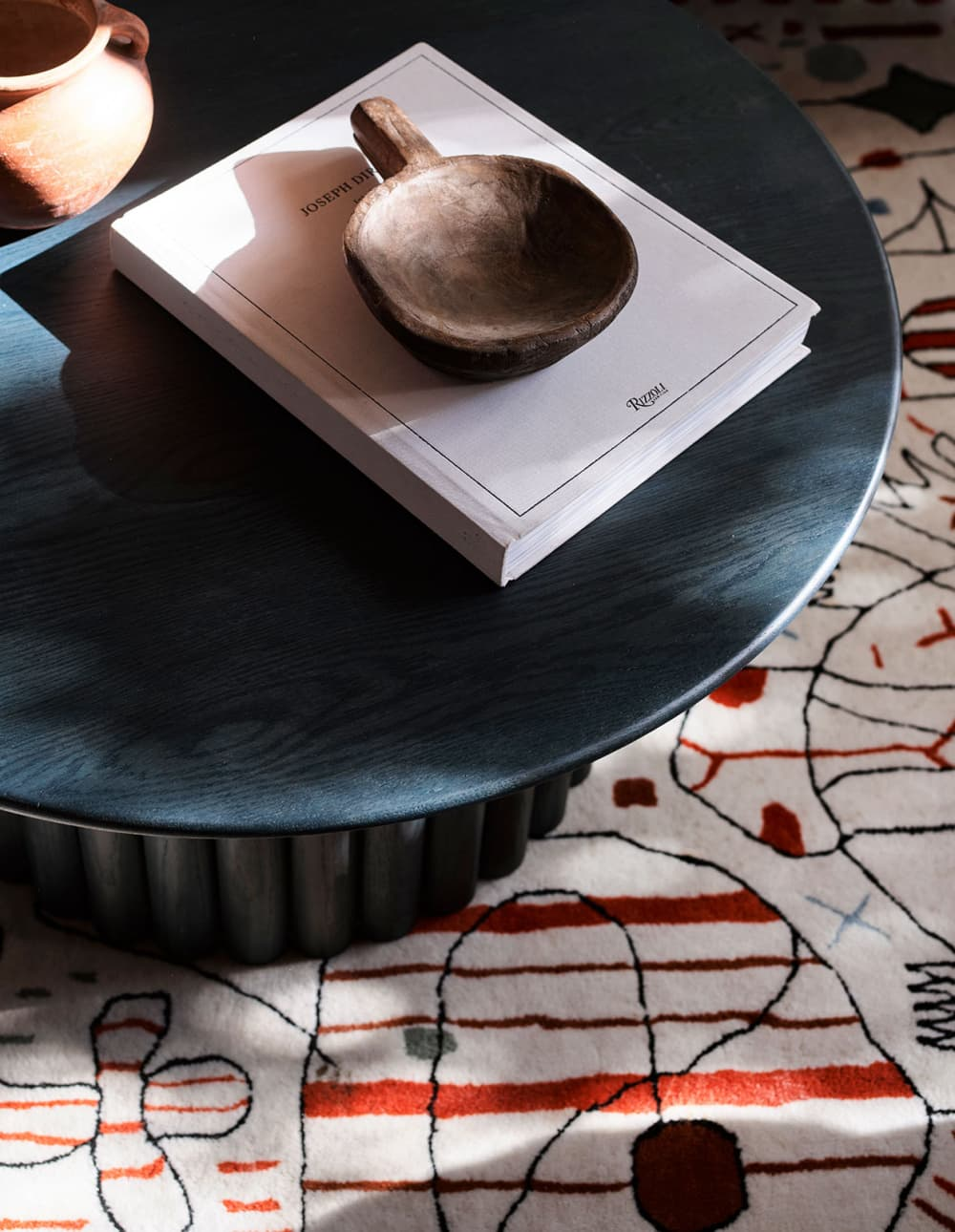 this is a close up of a rounded coffee table by the design files