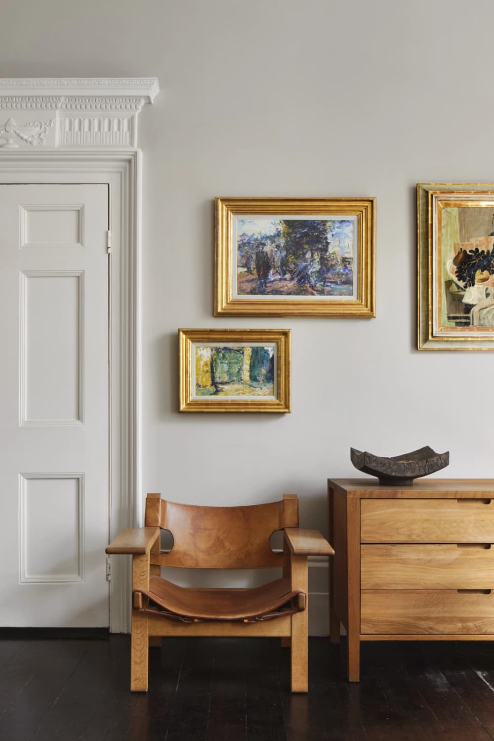 a collection of art in a home featured on Inigo