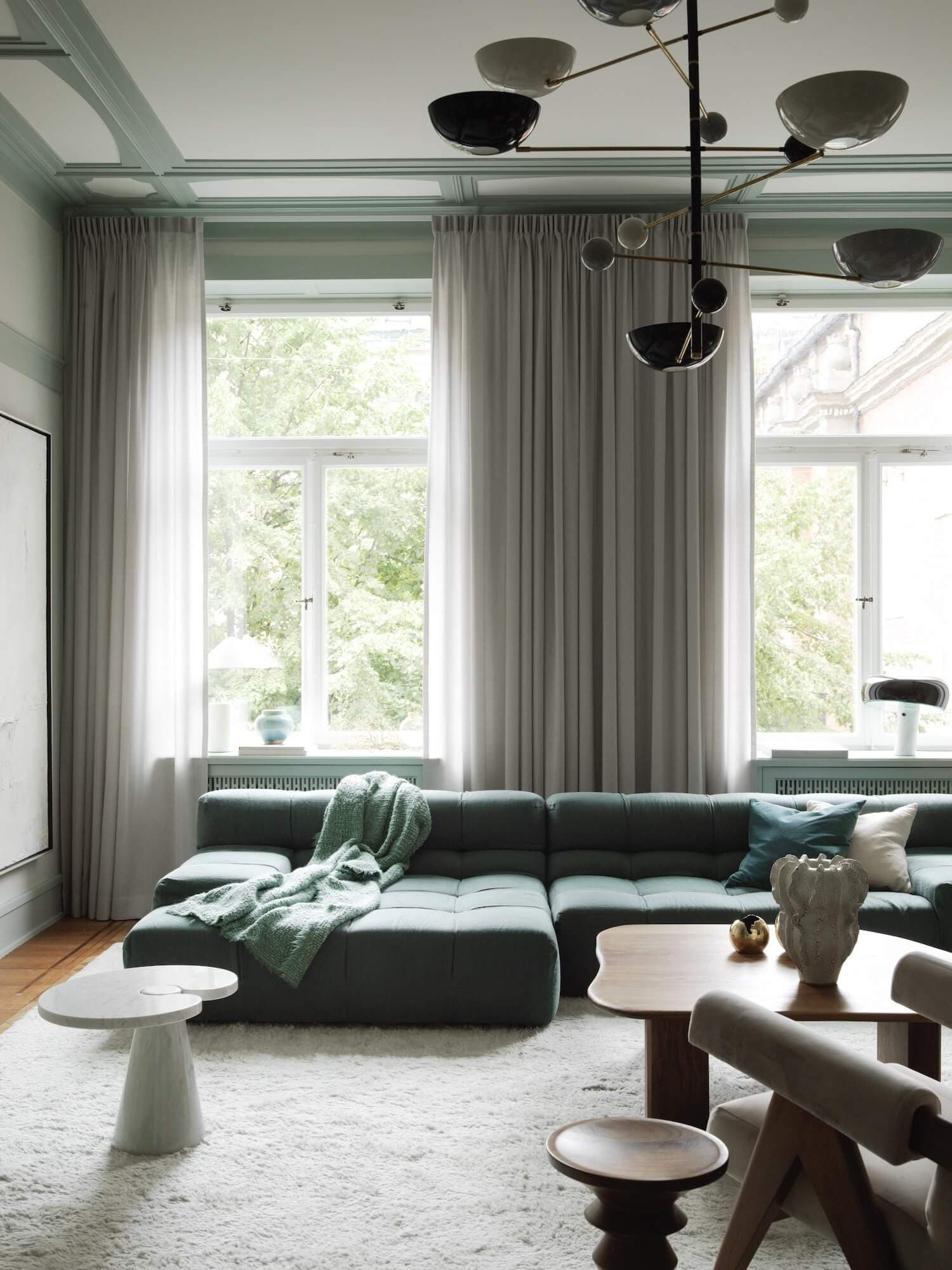 an example of a stunning blue velvet modular sofa in a contemporary home by frenchy fancy