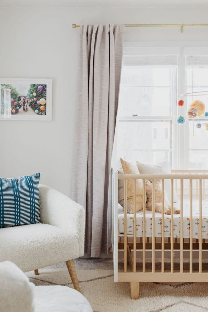 this is a relaxed nursery with planetry decor by the every mom