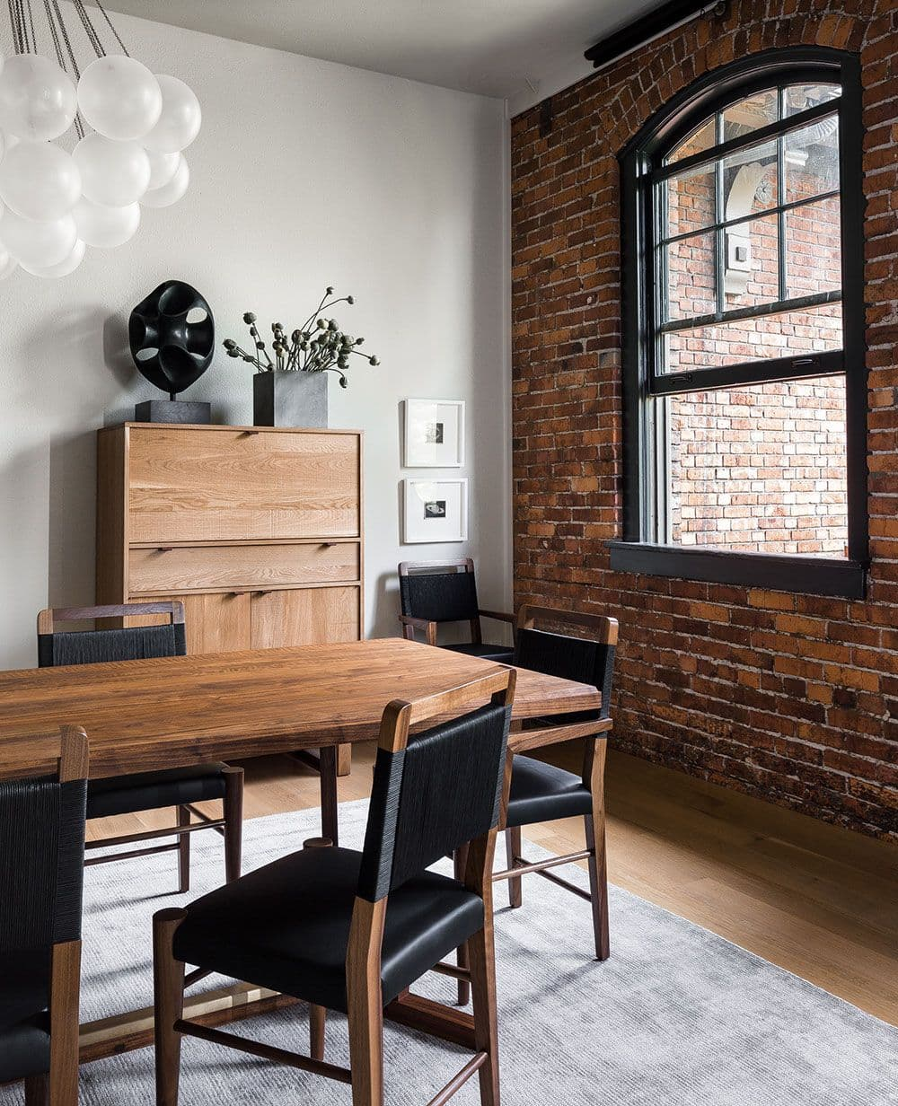 this is an industrial dining room with wooden features