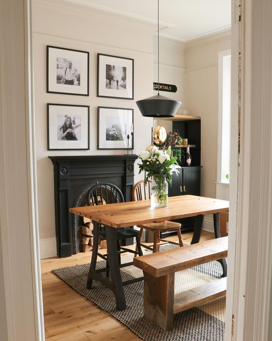 this is a dining room by house at the athfield featuing a houseof light pendant