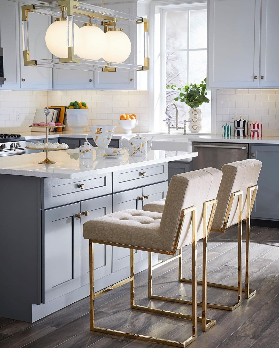 this is a kitchen by jonathan adler showing mixing metals