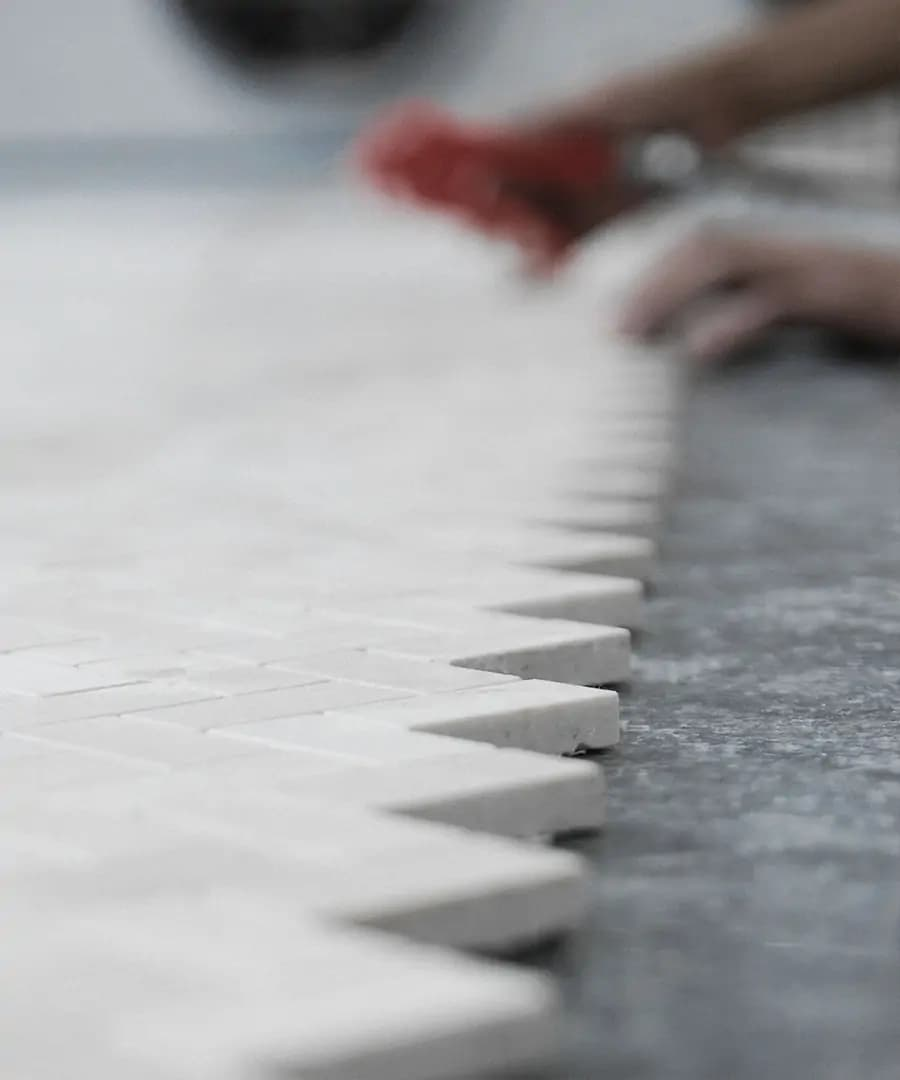 this is claybrook studio laying their mosaic marble tiles