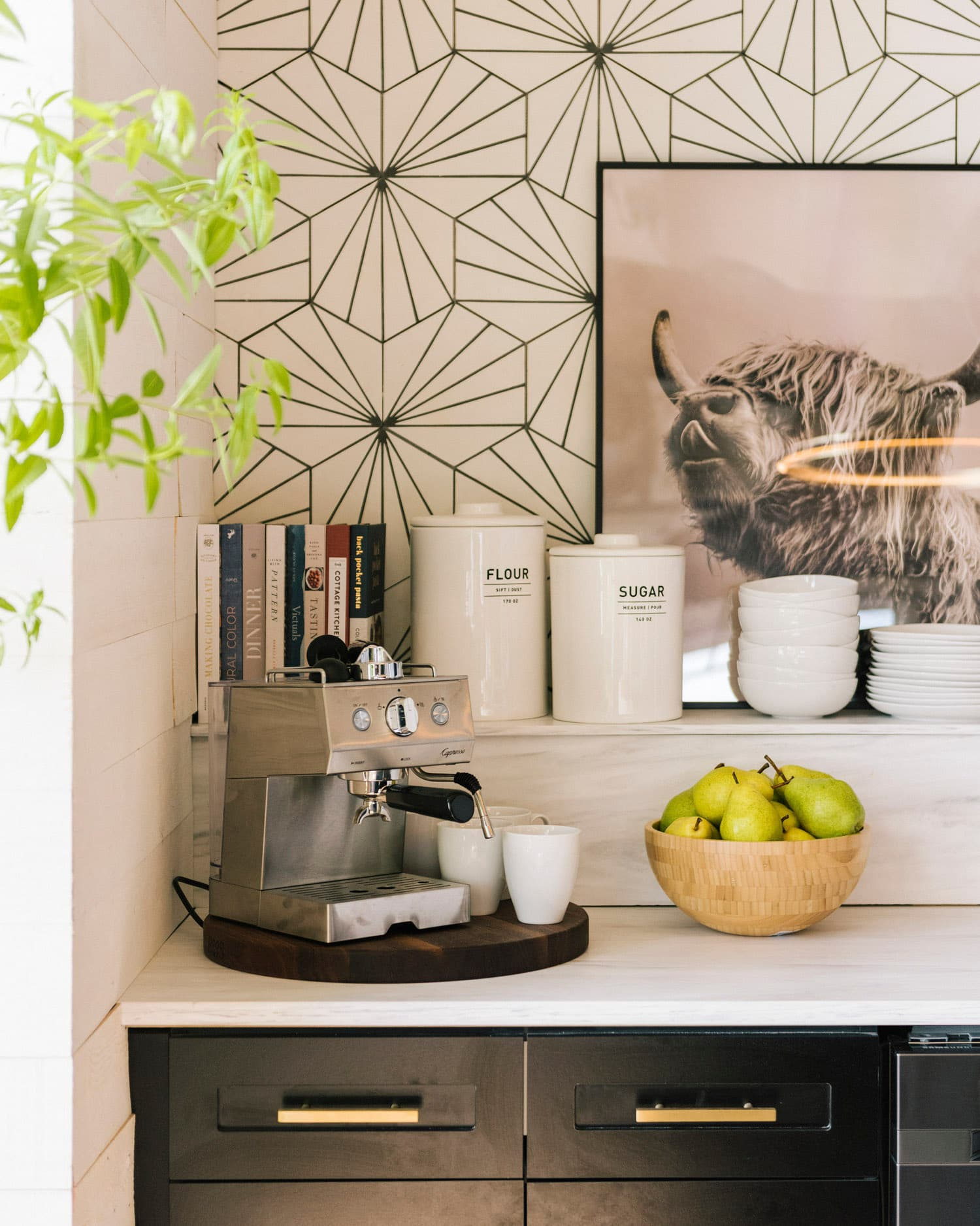 this is a mid century modern inspired kitchen with geometric wallpaper featured on front + main